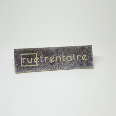 Labels in lasered synthetic material