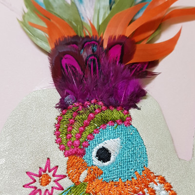 Embroidery with fur and feather applications