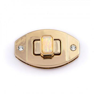Oval turn lock with iridescent bezel W1010544/50
